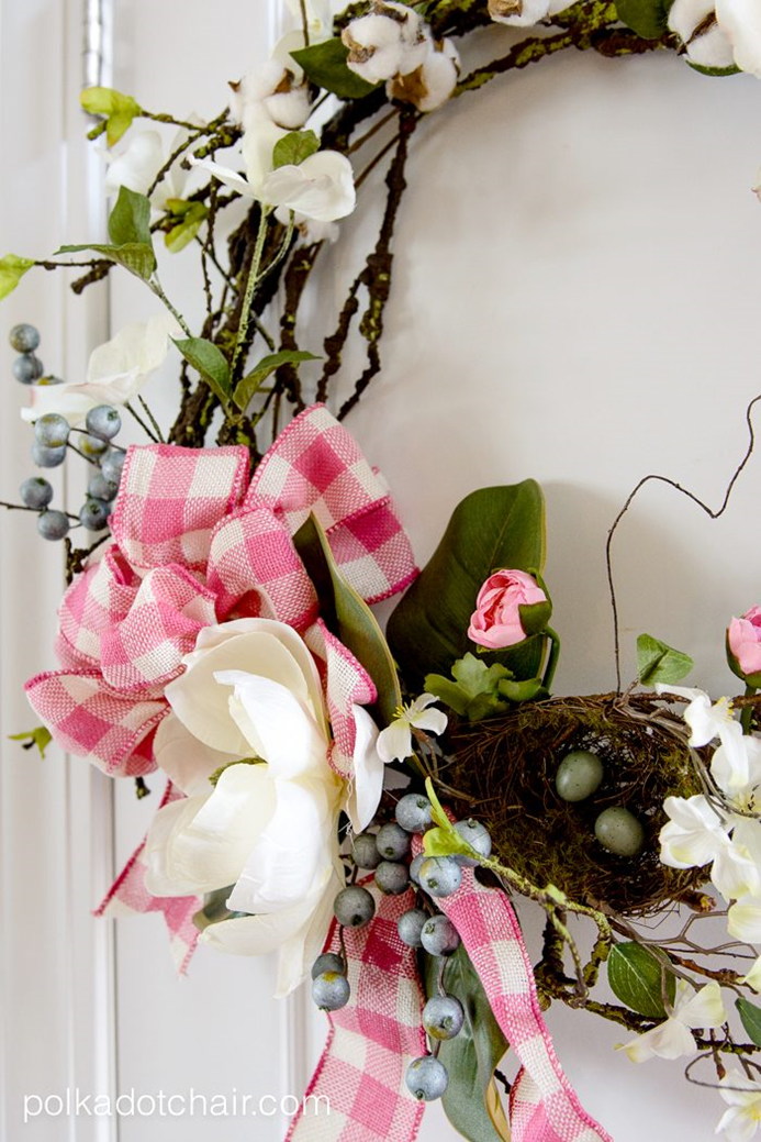 spring wreath with white flowers and pink ribbon
