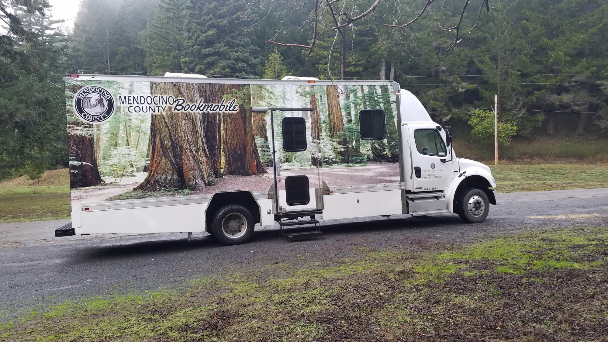 bookmobile parked in the trees