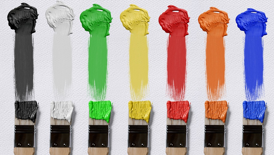 paint brushes with colorful smears of paint