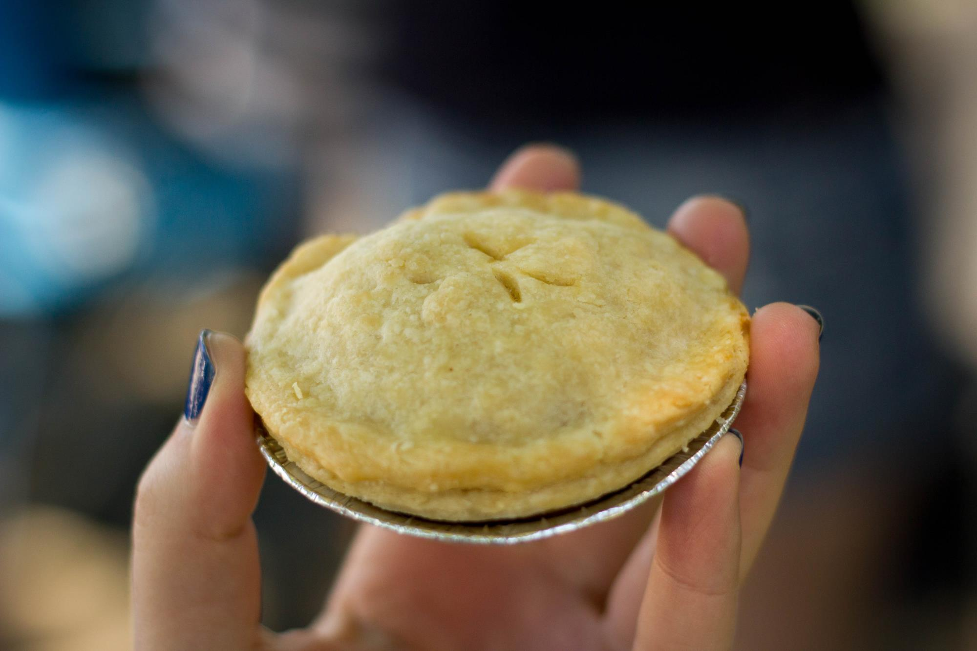 tiny pie held in hand