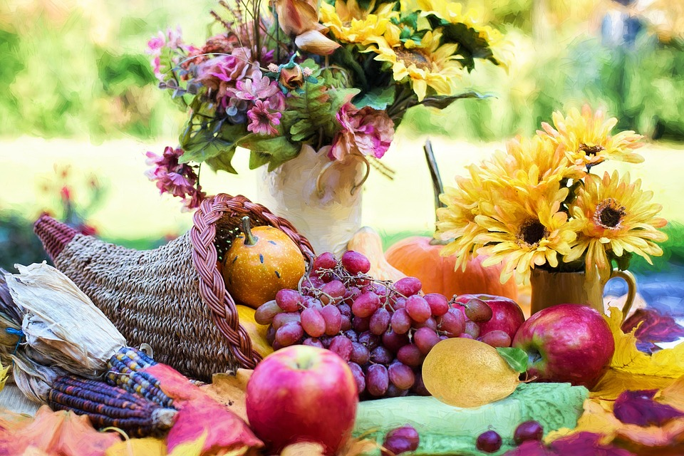 Cornucopia on table with flowers