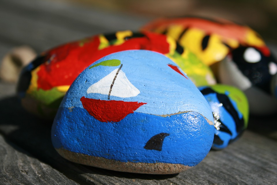 Sailboat on the ocean painted on a rock