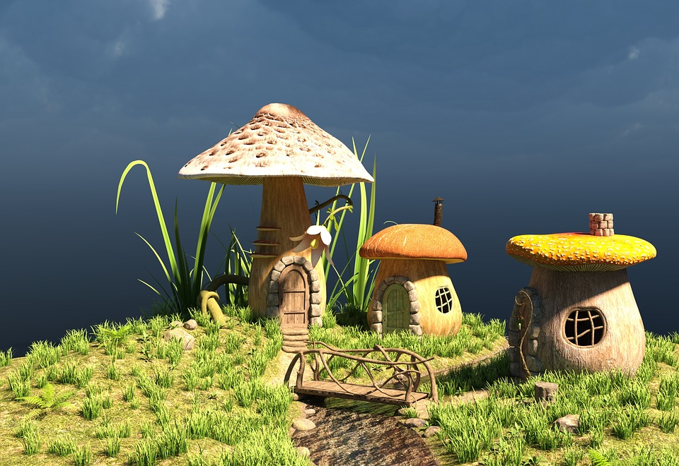 Small mushroom shaped houses on mossy hill
