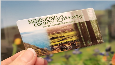 new library card with ocean, redwoods and vinyards on the front