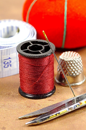 Needle and thread and thimble